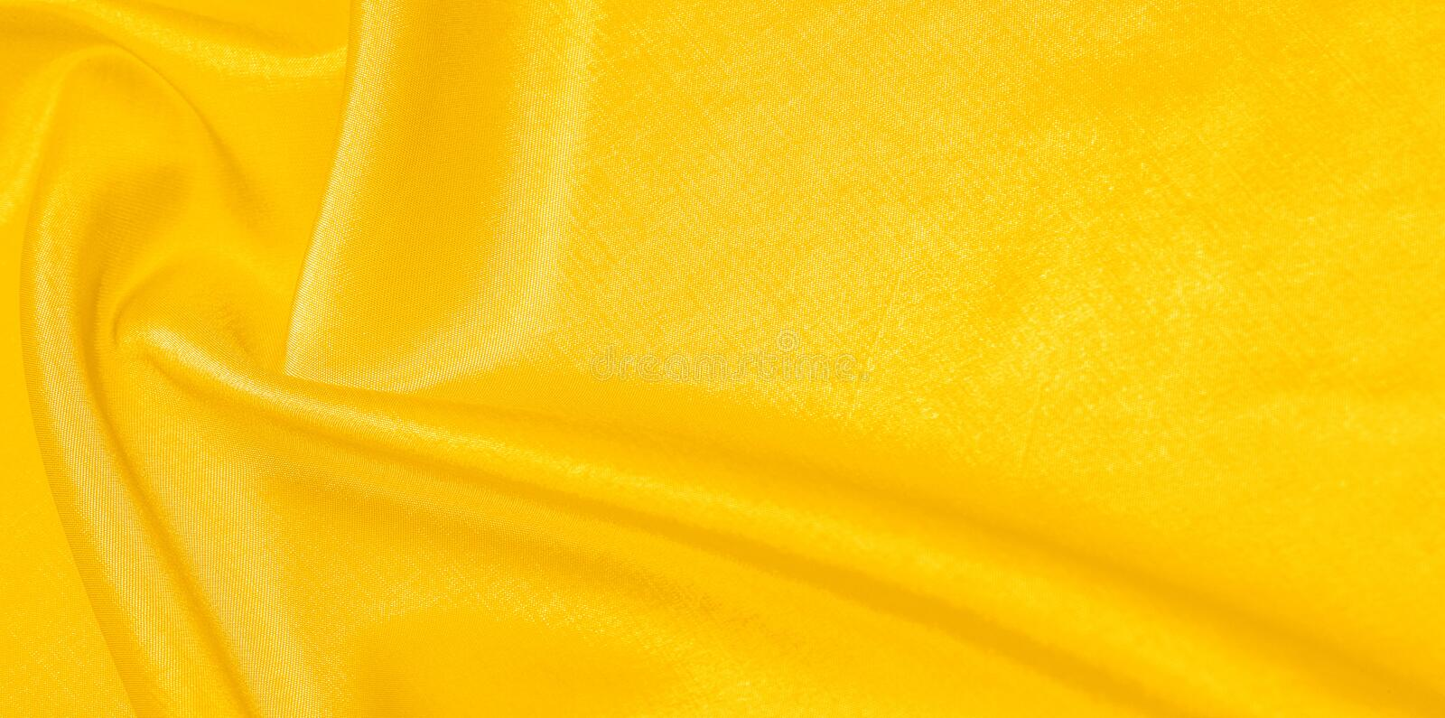 Pattern, background, pattern, texture, yellow silk fabric. This silk fabric is perfect for accents on your design, design and. Background, pattern, texture royalty free stock photo