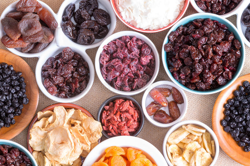 Background pattern and texture of dried fruit. Background pattern and texture of assorted dried fruit displayed in individual round bowls including goji berries royalty free stock photo