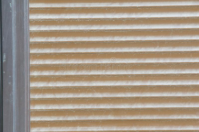 Background pattern, texture. Protective blinds - metal, external royalty free stock photo