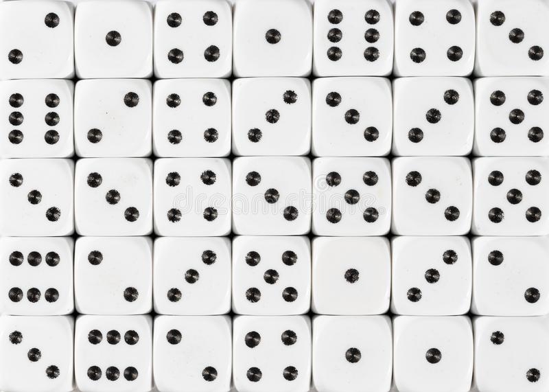 Background pattern of white dices, random ordered. Pattern background of white dices, random ordered royalty free stock image