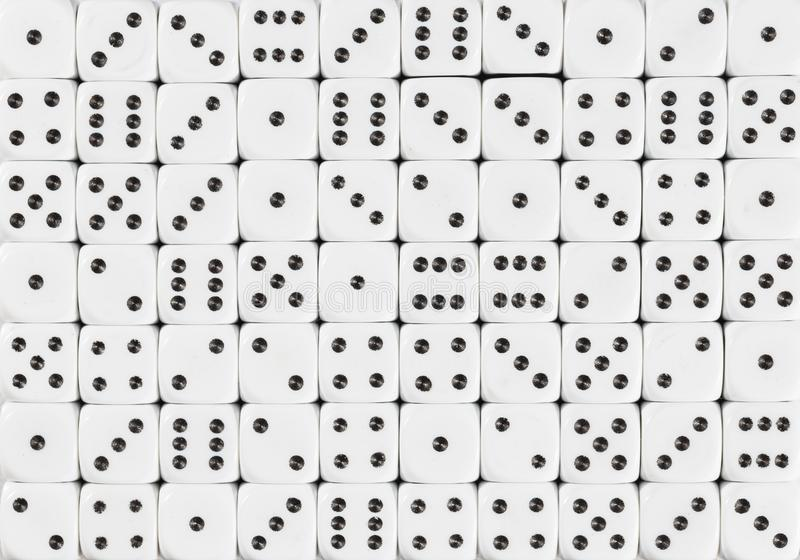 Background pattern of 70 white dices, random ordered. Pattern background of 70 white dices, random ordered stock image