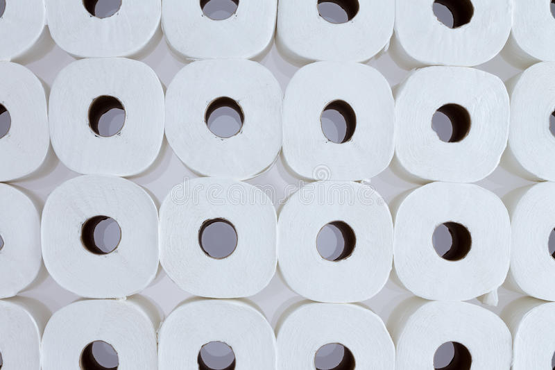 Background pattern of white toilet paper rolls royalty free stock photos