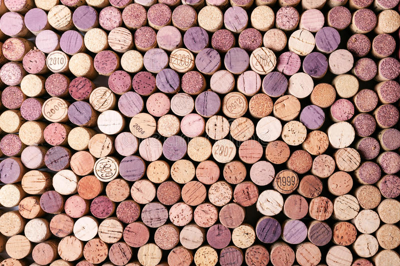Background pattern of wine bottles corks. Some with year stamp stock photography