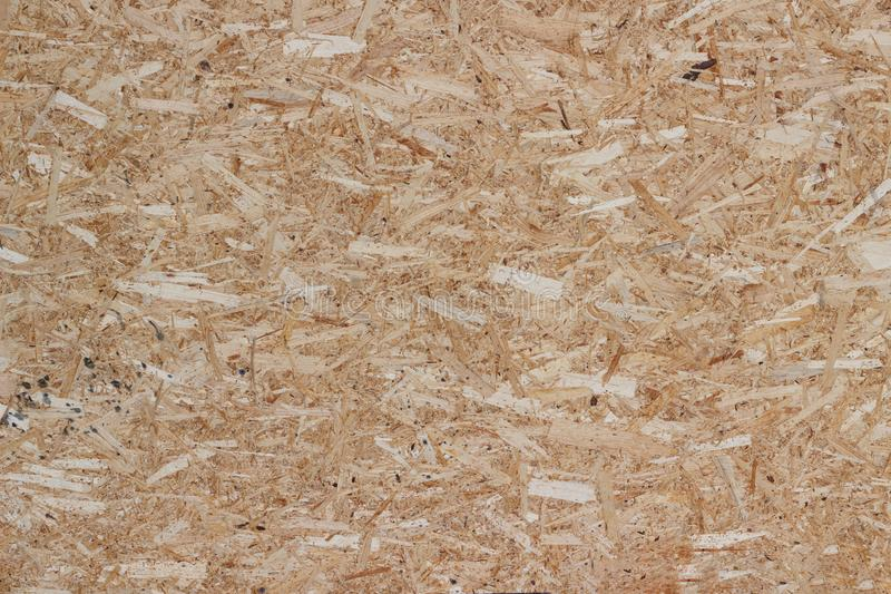 Background pattern wood chips wall nature. Remove the wall of pressed chips for the background frontally stock photography