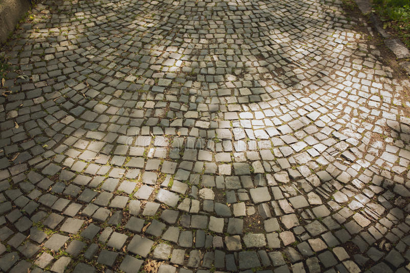 Background of paving stones at the street in light of sun. Background of old paving stones at the street in light of sun stock photography
