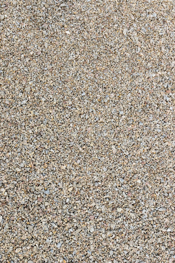 Background pea gravel brown. Texture of pea gravel of different factions brown vertical orientation royalty free stock photos