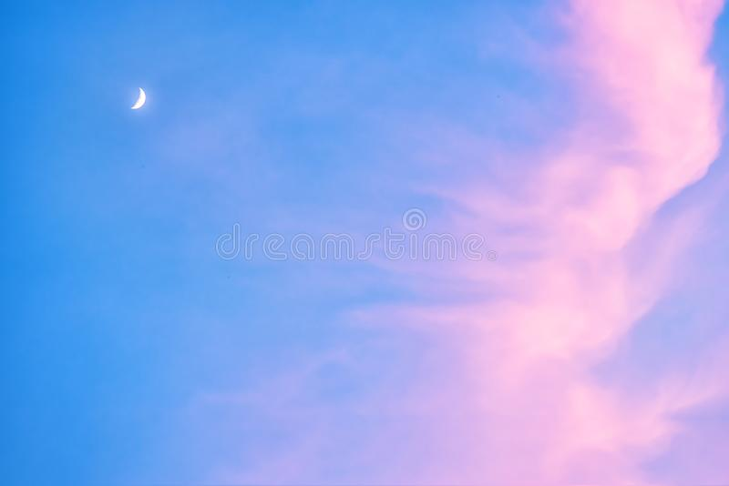Background photograph of a red full moon in a blue sky at sunset royalty free stock photos