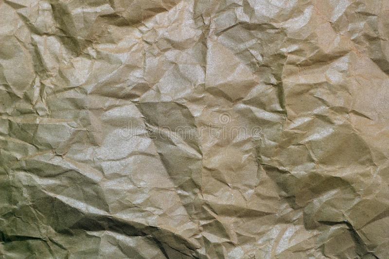 Wrinkled paper background. Texture of crumpled paper. Texture of crumpled old paper closeup. Background picture, transparency, clean, mulatto, cardboard, cunning royalty free stock image
