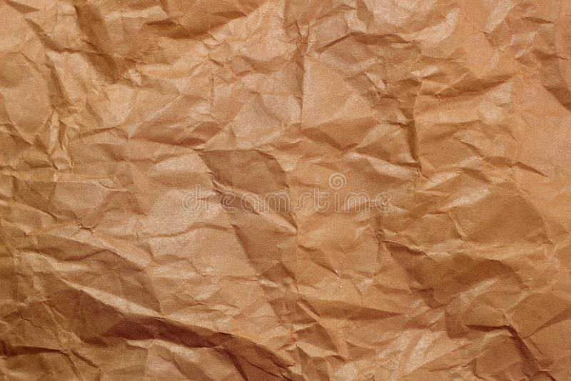 Wrinkled paper background. Texture of crumpled paper. Texture of crumpled old paper closeup. Background picture, transparency, clean, mulatto, cardboard, cunning stock photos