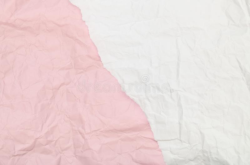Background of a piece of crumpled paper pink and white stock photography