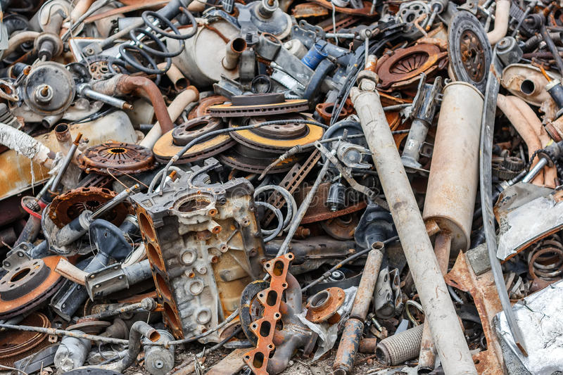 Background pile of rusted metal scrap. On the open air stock images