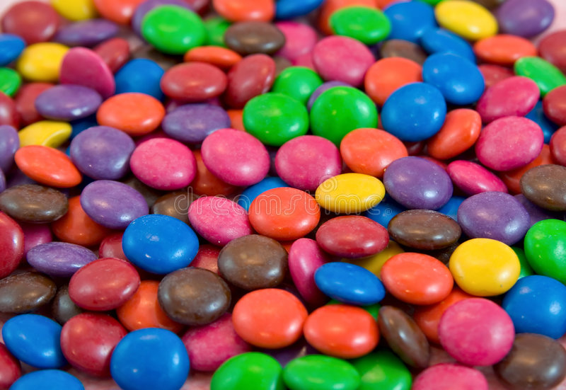 Background pile of smarties ch. Ocolates stock images