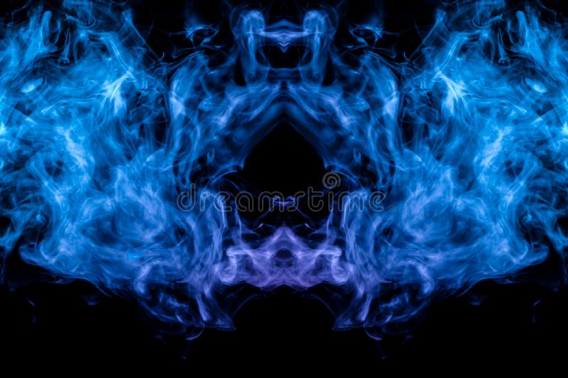 A background of pink, blue and white wavy smoke in the shape of a ghost`s head or a man of mystical appearance on a black isolate royalty free illustration