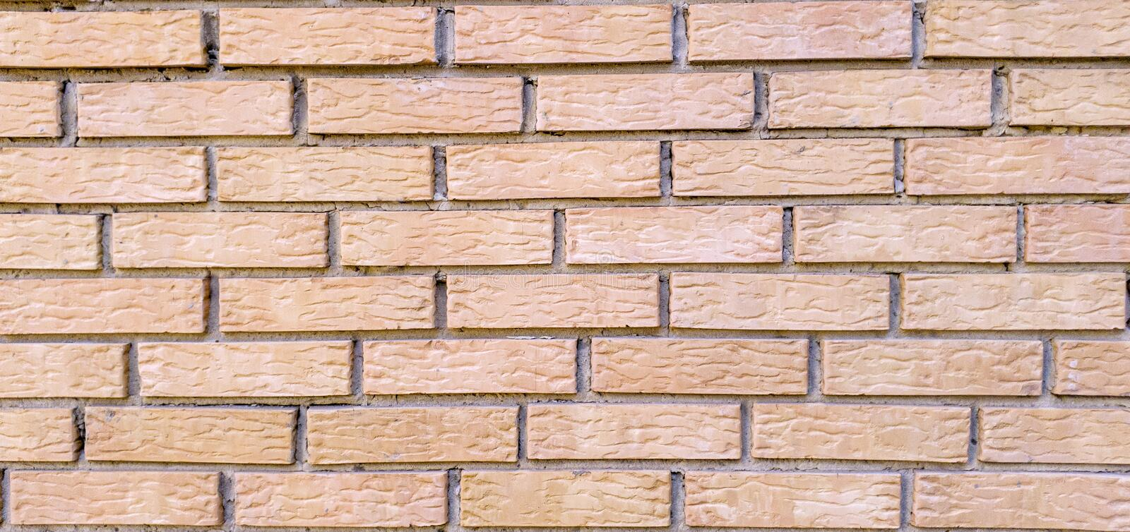 Background of pink bricks for decoration of advertising banners and other design purposes.  stock image