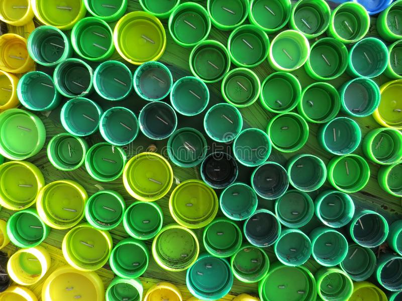 Background of plastic colorful bottle caps. Contamination with plastic waste. Environment and ecological balance. Art from junk. Festive and fun colored mosaic stock photos