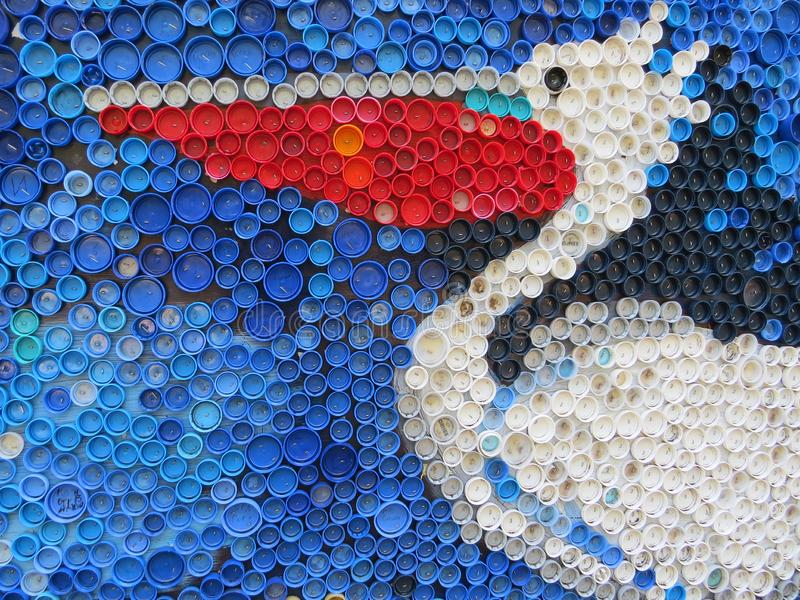 Background of plastic colorful bottle caps. Contamination with plastic waste. Environment and ecological balance. Art from junk. Festive and fun colored mosaic stock images