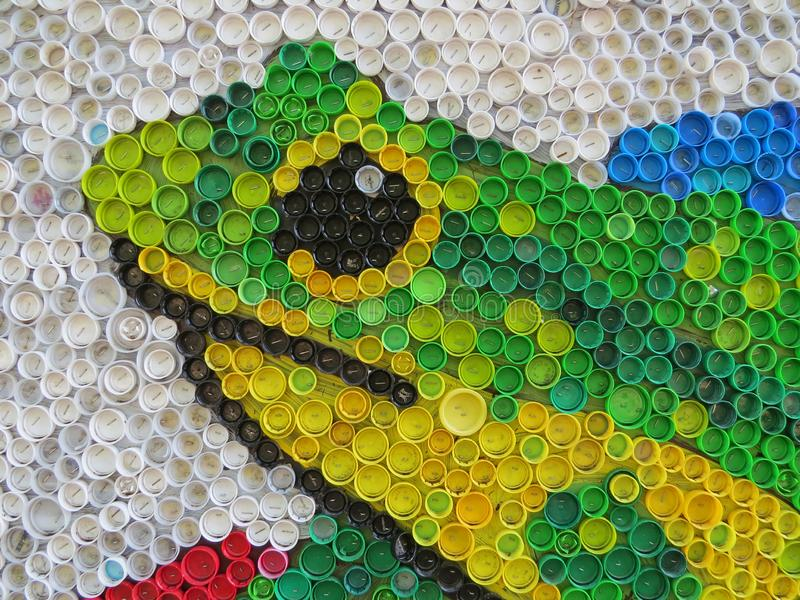 Background of plastic colorful bottle caps. Contamination with plastic waste. Environment and ecological balance. Art from junk. Festive and fun colored mosaic stock photo