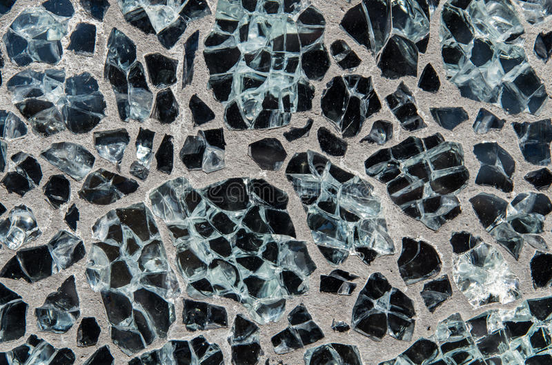 Background of polished black stones set in cement or concrete. A background or texture of black stones or marble, set into cement or concrete and polished to royalty free stock image