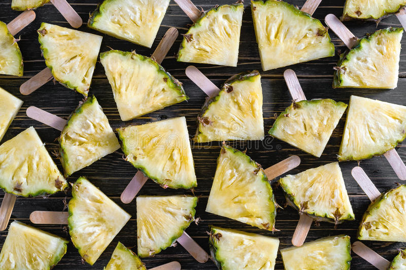 Background, Popular summer fruit with yummy pineapple on a stick stock image