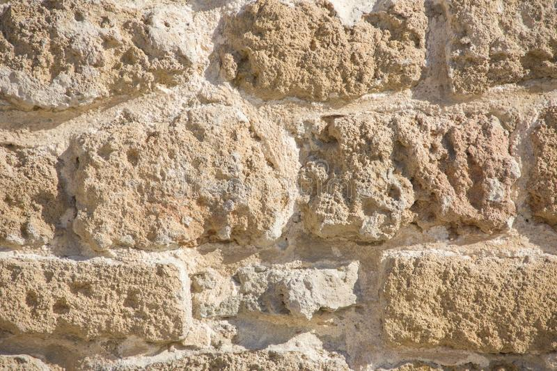 Background porous stone structure, fragment of an ancient stone wall in Jaffa, Israel stock photos