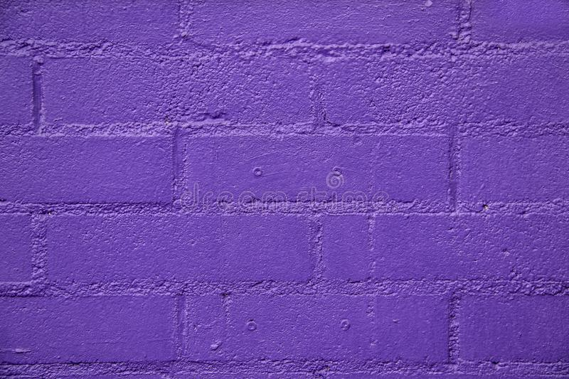 Background of purple painted bricks - close-up - bright and pretty royalty free stock images