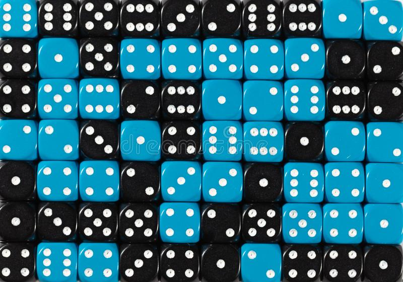 Background of 70 random ordered black and blue dices. Pattern background of 70 random ordered black and blue dices royalty free stock photos