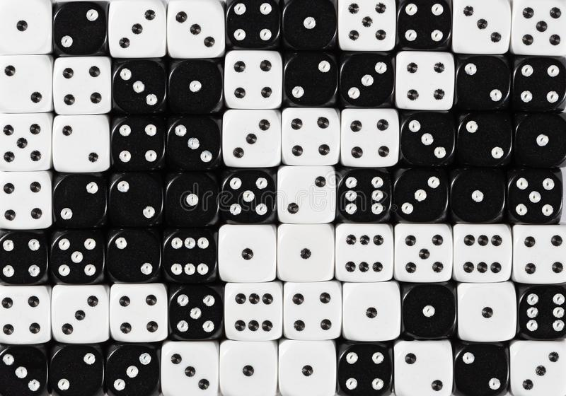 Background of 70 random ordered black and white dices. Pattern background of 70 random ordered black and white dices royalty free stock photo
