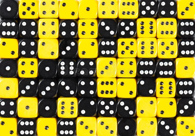 Background of 70 random ordered black and yellow dices. YellowPattern background of 70 random ordered black and yellow dices stock images