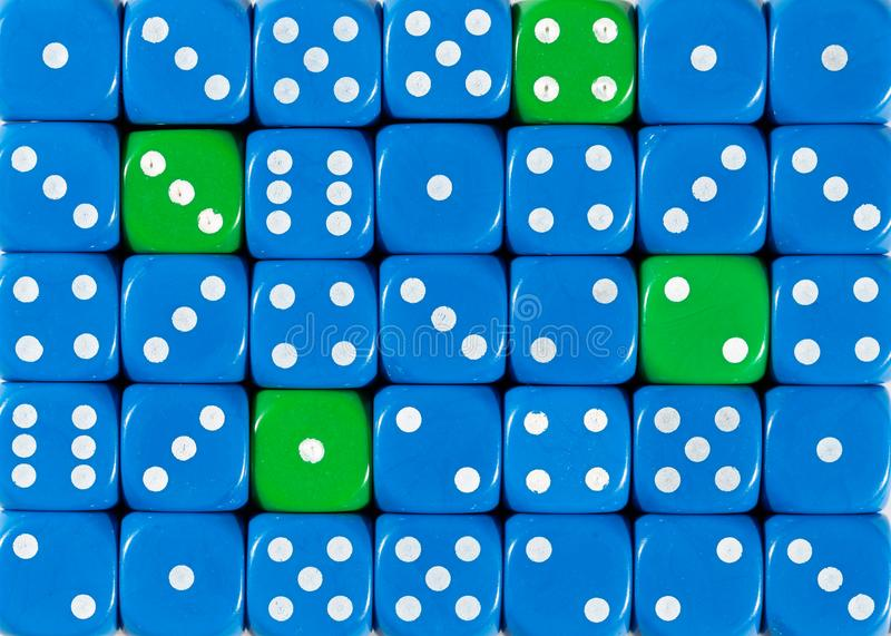 Background of random ordered blue dices with four green cubes. Pattern background of random ordered blue dices with four green cubes stock photo