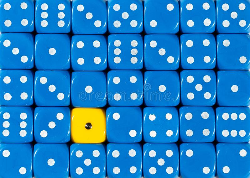 Background of random ordered blue dices with one yellow cube. Pattern background of random ordered blue dices with one yellow cube royalty free stock photo