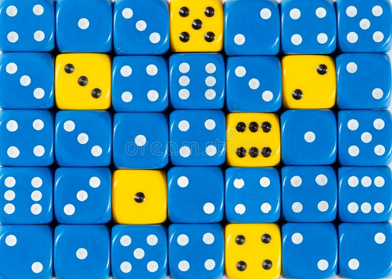 Background of random ordered blue dices with six yellow cubes. Pattern background of random ordered blue dices with six yellow cubes stock photos