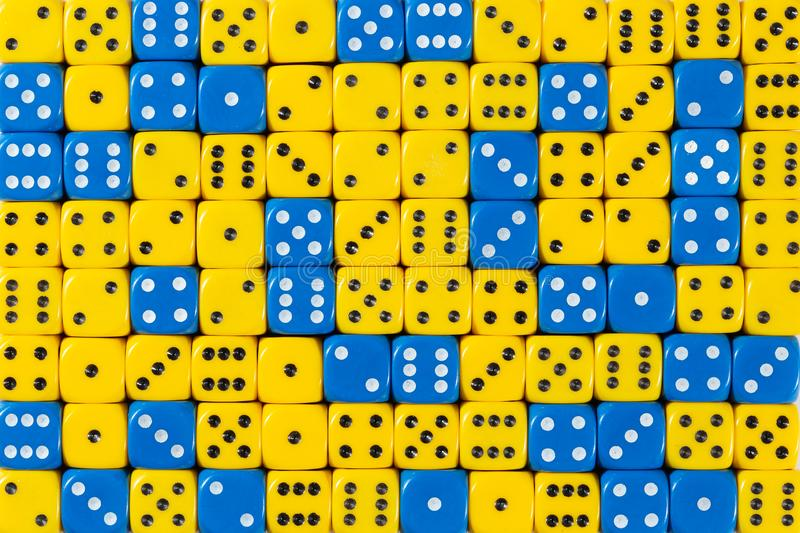 Background of 140 random ordered blue and yellow dices. Pattern background of 140 random ordered blue and yellow dices royalty free stock image