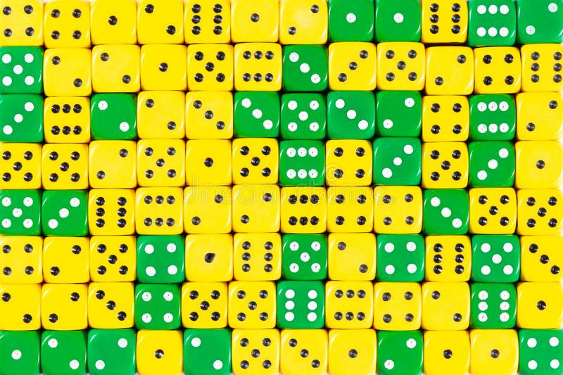 Background of 140 random ordered green and yellow dices. Pattern background of 140 random ordered green and yellow dices stock photography