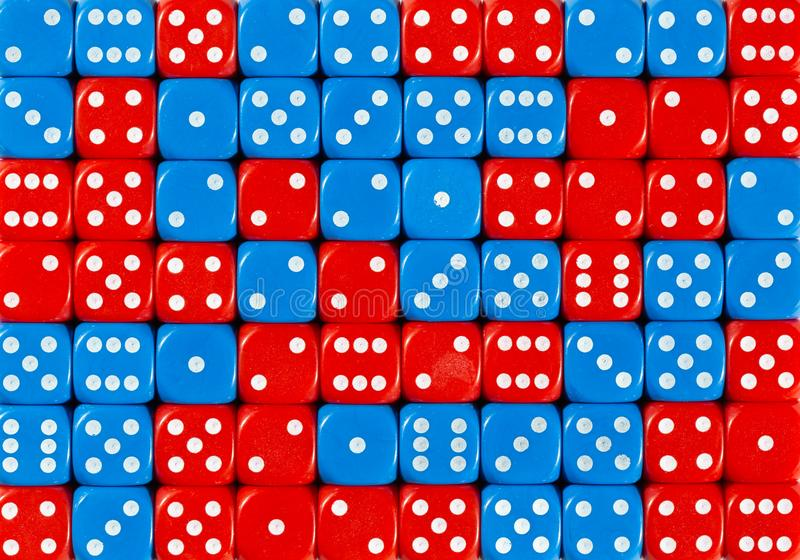 Background of 70 random ordered red and blue dices. Pattern background of 70 random ordered red and blue dices stock image