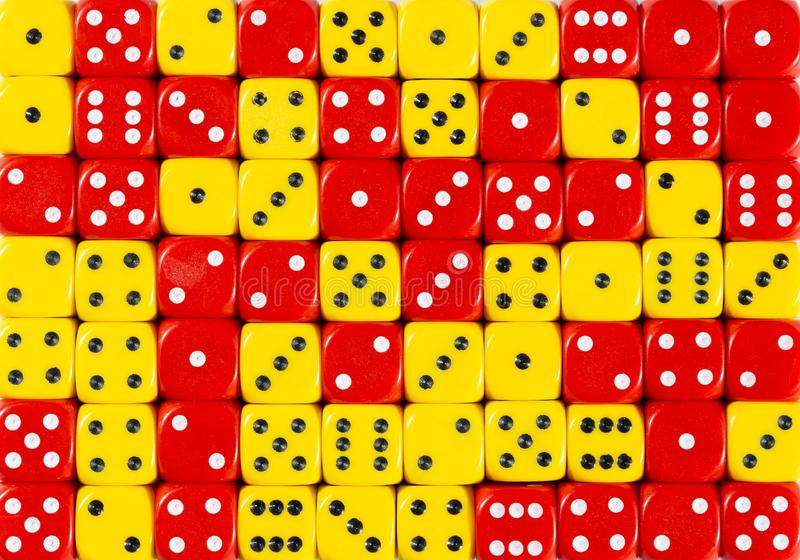 Background of 70 random ordered red and yellow dices. Pattern background of 70 random ordered red and yellow dices stock photos