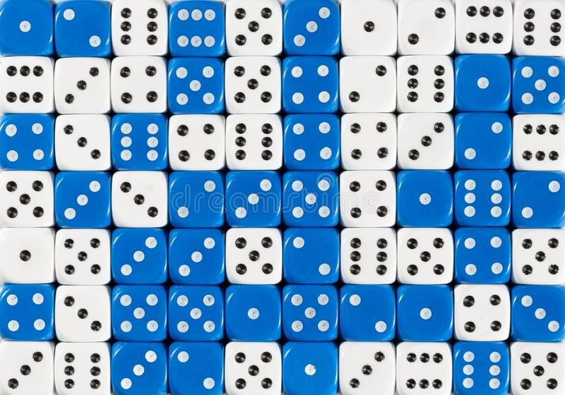 Background of 70 random ordered white and blue dices. Pattern background of 70 random ordered white and blue dices royalty free stock photo
