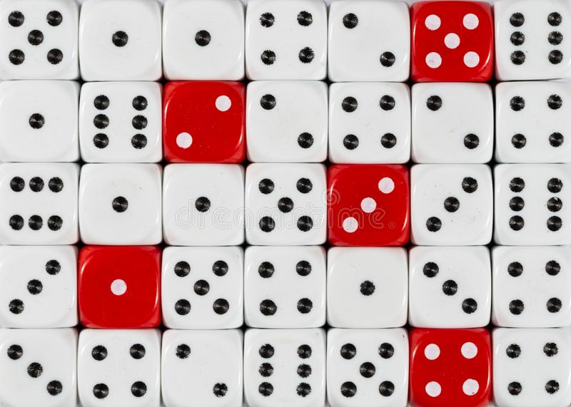 Background of random ordered white dices with five red cubes royalty free stock images