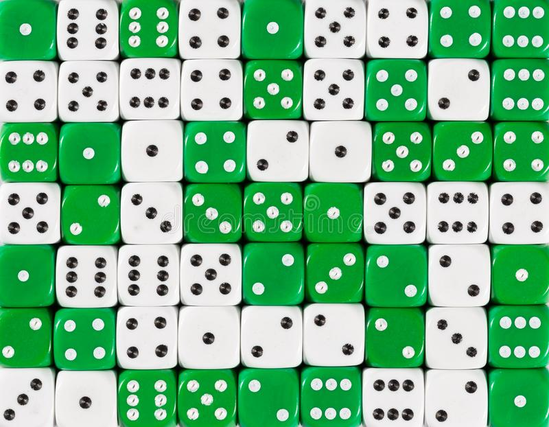 Background of 70 random ordered white and green dices. Pattern background of 70 random ordered white and green dices stock photography