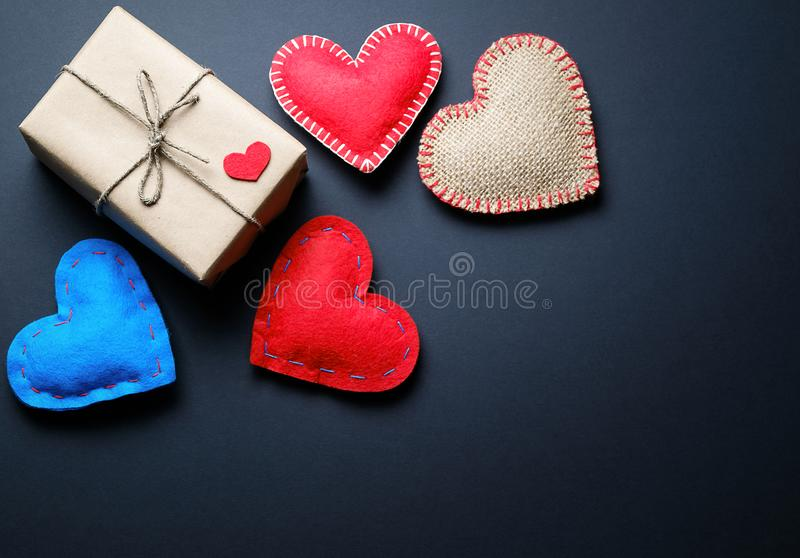 Background Of Red And Blue Hearts Or Valentines, On A Black Background. A gift for the holiday of Valentine`s Day, handmade.  royalty free stock photo