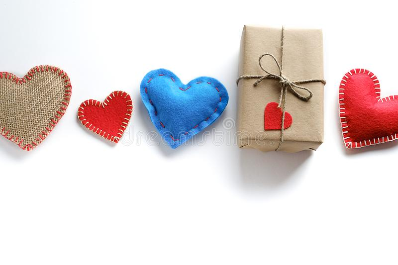 Background Of Red And Blue Hearts Or Valentines, On A White Background. A Gift For The Holiday Of Valentine`s Day, Handmade.  royalty free stock photos