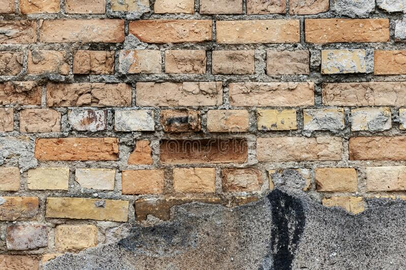 Red Brickwall with broken off plaster royalty free stock photo