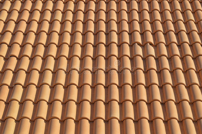 Background Of Red Clay Tiles. Spanish red round clay tiles for use as a background or backdrop royalty free stock photos