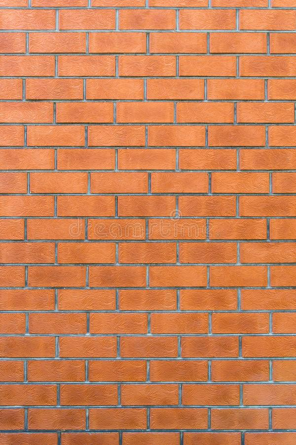 Background from red hardened bricks laid horizontally. Copy space for custom text. Vintage wall. Background from red hardened bricks laid horizontally. Copy stock photo