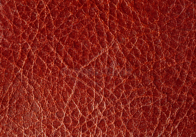 Background from a red leather. Unusual textural background from a red leather stock photography