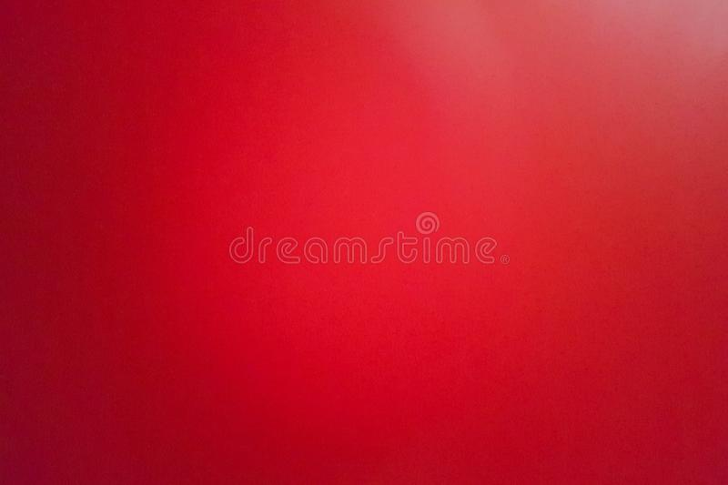 Background of red leather shoot blurry and grainy by mobile camera. Blurry and grainy of red leather background; gradient shade of red by light; shoot from royalty free stock images