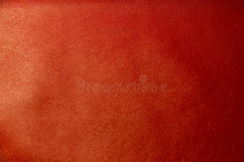 Red leather textural background. Background red leather texture close-up shot macro royalty free stock image
