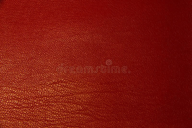 Red leather textural background. Background red leather texture close-up shot macro royalty free stock photo