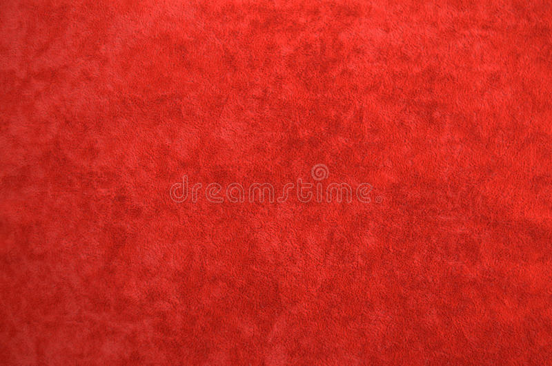 Background from a red perfect suede fabric. royalty free stock images