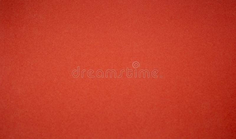 Background from a red perfect suede fabric. Velvet texture royalty free stock images