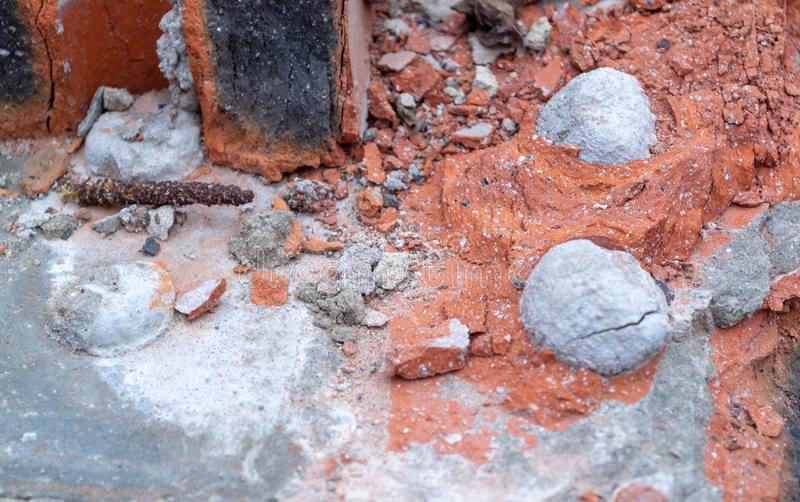 Background: remnants of permitted brickwork on concrete. Red brick and gray concrete royalty free stock photo